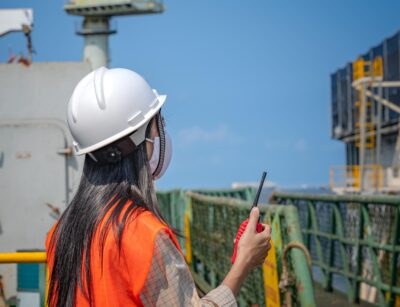 Woman engineering working in place at job site under situation of COVID 19, working in order under control of safety regulation